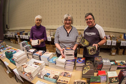 BBF Steering Committee members setting up for the Book Fair.