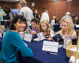 Author Margaret Peterson Haddix and some fans.