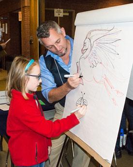 Illustrator Mark Wayne Adams draws along with a BBF attendee.