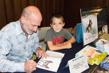 Author Michael J. Rosen signs a book for a BBF attendee