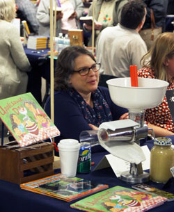 Author Lisa Amstutz exhibited tools for making applesauce alongside her new book Applesauce Day.