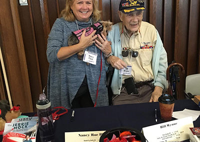 Author Nancy Roe Pimm and the subject of her book, WWII veteran Bill Wynne and his dog Smoky Too
