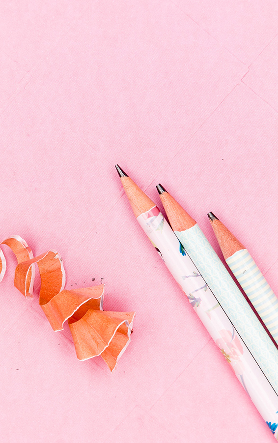 Three Pencils on a pink paper